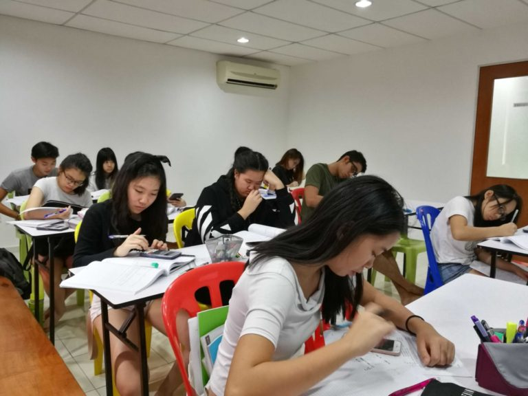 This is the preferred, the best and the top Cambridge IGCSE centre tuition classroom in Malaysia with students from addresses nearby Subang Jaya USJ, Ara Damansara, Sunway, Tropicana, SS2, Putra Heights, Kepong, Shah Alam, Puchong, Bandar Utama, Kota Damansara, TTDI and Klang. They are coming from different international school and private tutor homeschool in Malaysia doing Cambridge IGCSE and A levels syllabus such as Biology, Chemistry, Accounting, Business studies, Physics, Economics, Add Maths, IGCSE Combined Science, Chinese Foreign Language, Chinese Second Language, Malay foreign language, Mathematics, First language English and Second language english in this igcse tuition centre in Subang USJ called TWINS Education. At year end, IGCSE Intensive Workshop Class or Seminar will be conducted to those who need the extra boost or IGCSE revision. There are part time working adult who wish to improve their English in this English language centre. This include Anglia English for business tuition classes. People sometimes refer English language centre because of IELTS. In this image, students are practicing their exam papers in this IGCSE centre. They also offer E-Learning IGCSE online tuition Malaysia to international students.