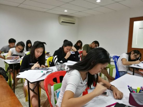 This is the preferred, the best and the top Cambridge IGCSE centre tuition classroom in Malaysia with students from Subang Jaya USJ, Ara Damansara, Sunway, Putra Heights, Petaling Jaya PJ, Shah Alam, Puchong and Klang. They are coming from different international school and private tutor homeschool in Malaysia doing Cambridge IGCSE and A levels syllabus such as Biology, Chemistry, Accounting, Business studies, Physics, Economics, Add Maths, IGCSE Combined Science, Mathematics and first language English second language english in this igcse tuition centre in Subang USJ called TWINS Education. At year end, IGCSE Intensive Workshop Class or Seminar will be conducted to those who need the extra boost or IGCSE revision. There are part time working adult who wish to improve their English in this English language centre. This include Anglia English for business tuition classes. At the end of the English lesson they will register for Anglia English exam here in TWINS Education. They are also an Anglia exam centre for English business tuition examination. People sometimes refer us as an business English language centre. In this image, students are practicing their igcse accounting past year papers 0452 and igcse english second language past year papers 0510 0511 in this IGCSE centre. They also offer E-Learning IGCSE online tuition Malaysia and international students.